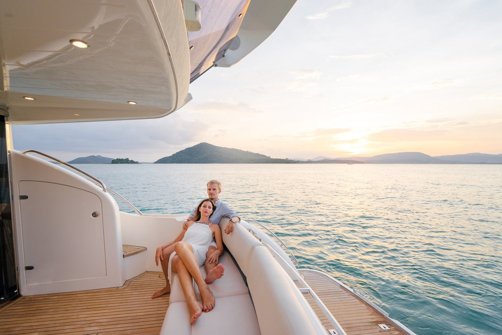 Young Couple Sitting Together on Yacht